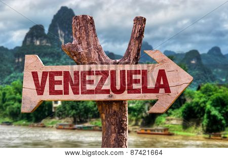Venezuela wooden sign with countryside background