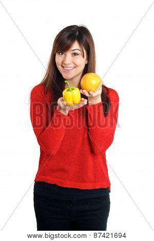 Asian Girl Holding Bell Pepper And Orange