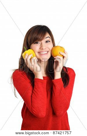 Asian Girl Pressing Fruits And Vegetable Against Her Face