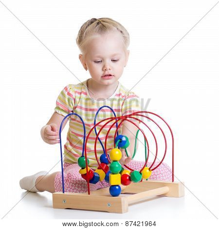 Toddler Girl Playing With Colorful Toy