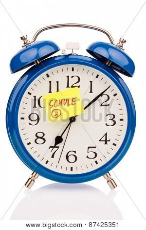 an alarm clock with a sticky note school as a symbol photo for starting school