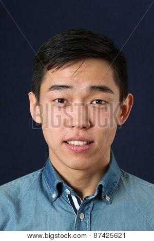 Smiling young Asian man looking at camera