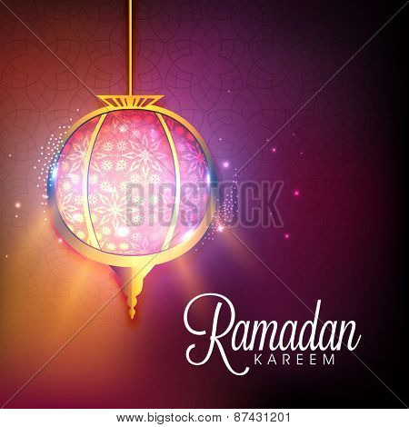 Illuminated hanging lantern on shiny purple and orange color for Islamic holy month of prayers, Ramadan Kareem celebrations.
