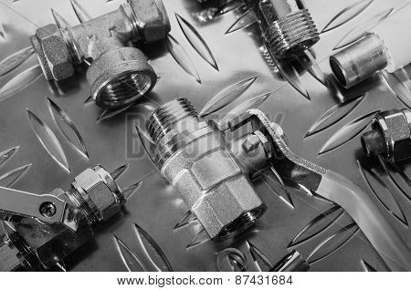 Plumbing Kit On A Metal Surface