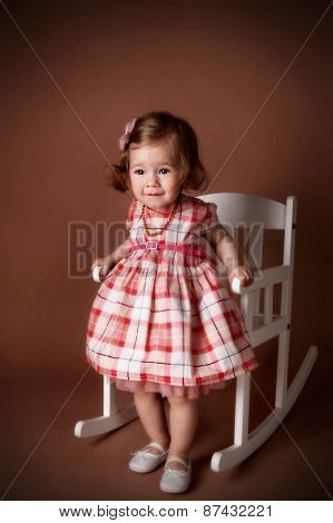 Pretty Little Girl In A Rocking Chair