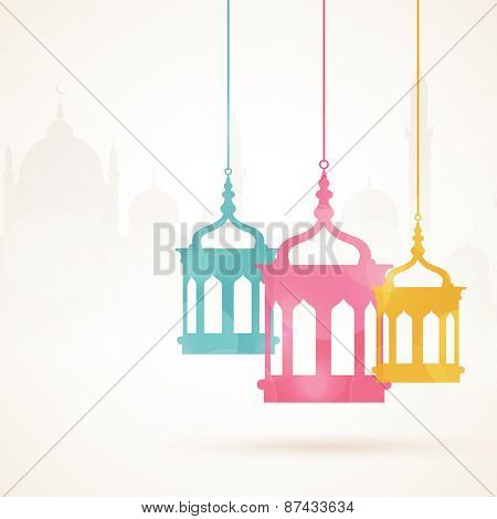 Holy month of muslim community, Ramadan Kareem celebration with colorful hanging arabic lamps on islamic mosque sihouette background.