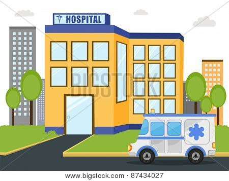 Hospital building with emercency ambulance vehicle standing outside.