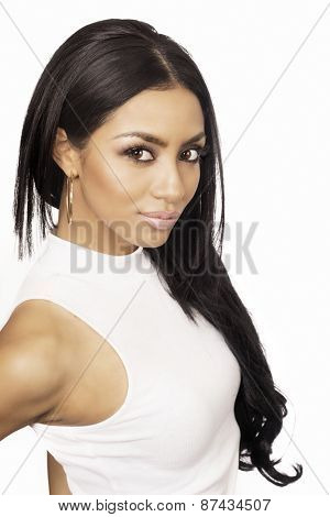 Beautiful young woman with long straight dark hair wearing classic white top against white background