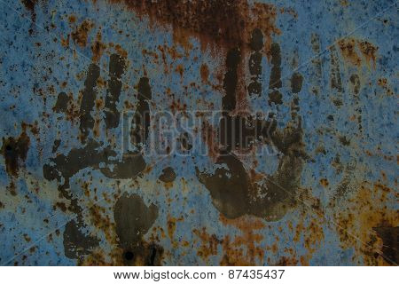 Handprints On Old Rusty Fence