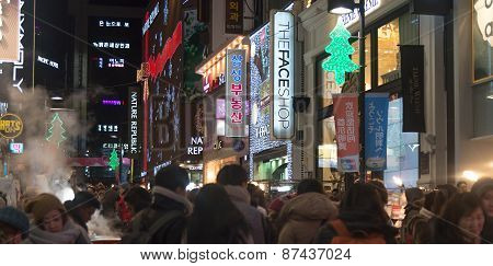 Urban Scene With Crowd People At  Shopping Street At Night  In Seoul ,south Korea.