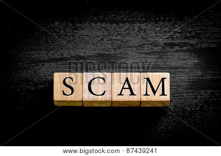 Word Scam Isolated On Black Background With Copy Space