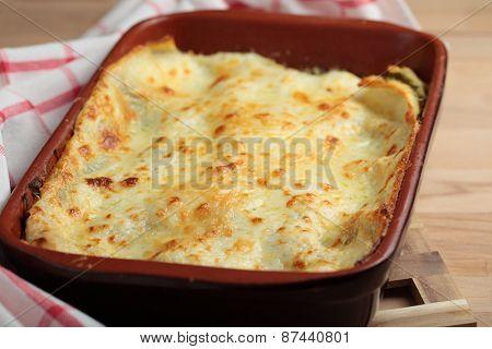 Lasagna with arugula in a baking dish