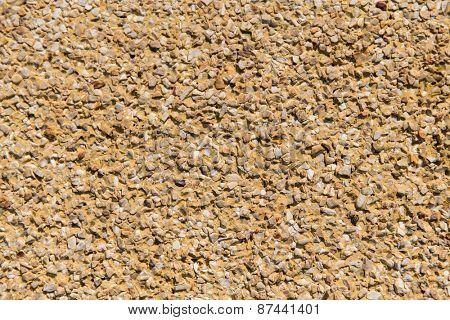 background, design and texture concept - grainy stone decorative tile texture