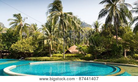 summer holidays, tourism, travel and leisure concept - swimming pools at thailand touristic resort
