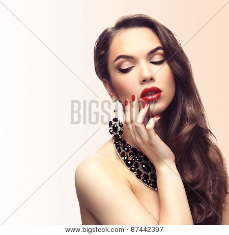 Beauty Model Woman with Long Brown Wavy Hair. Healthy Hair and Beautiful Professional Makeup.