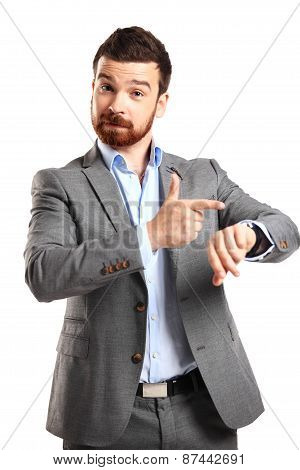 young man looking at watch over white background