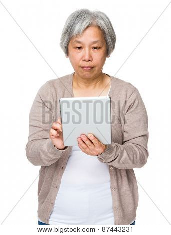 Old lady use of tablet