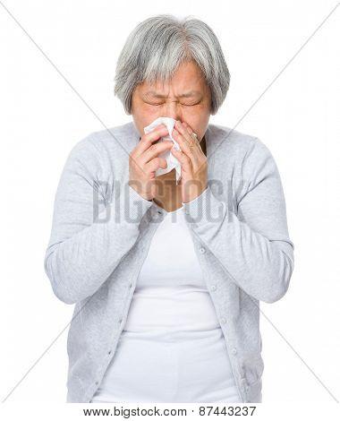 Asian woman sneeze