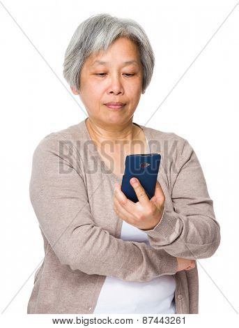 Retired woman read on cellphone