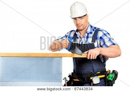 Male construction worker in working clothes, helmet and tools. Isolated over white.