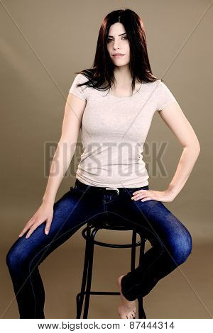 Gorgeous Lady Posing And Looking Sitting On Chair