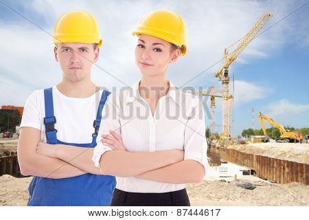 Man Builder And Business Woman Architect In Helmet