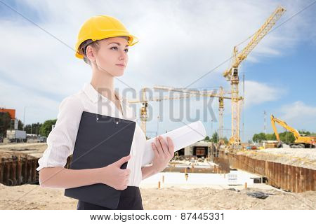 Business Woman Architect In Yellow Builder Helmet