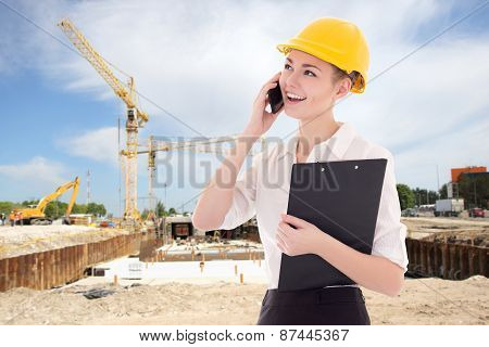 Young Beautiful Business Woman Architect In Builder Helmet Talking By Phone