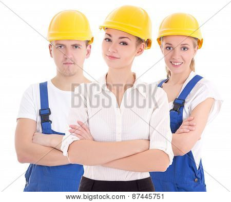 Team Work Concept - Two Young Women And Man In Blue Builder 's Uniform Isolated On White
