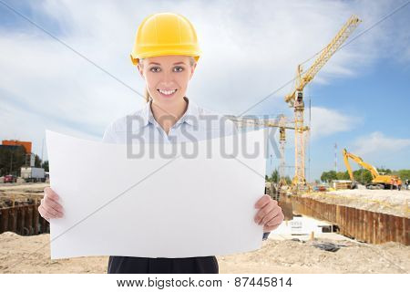 Happy Business Woman Architect In Yellow Builder Helmet Holding Building Plan
