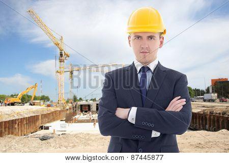 Handsome Business Man In Builder's Helmet