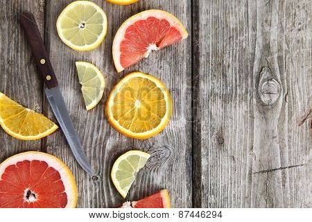 Citrus Fruits And A Knife