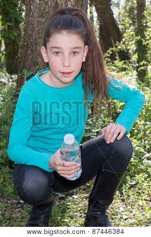 Lovely Nice Girl With A Bottle In Hands