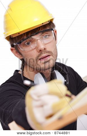 Worker Making Notice