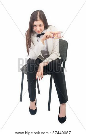 Pretty businesswoman with roubles sits on chair