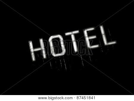 Illuminated sign HOTEL at night