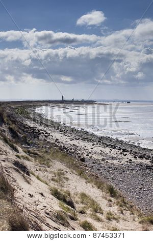 Spurn Point Coastline With Lighthouse