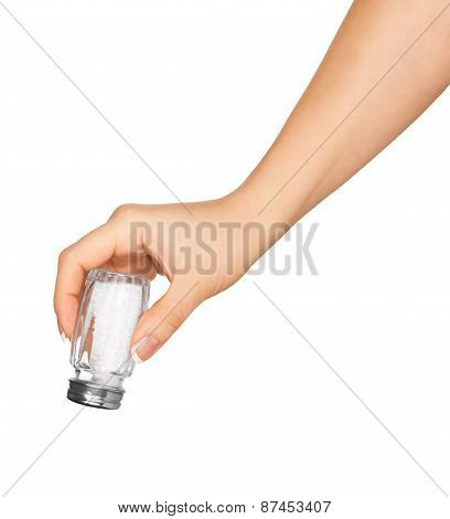 Hand Holding A Glass Saltcellar With Salt Isolated On A White Background