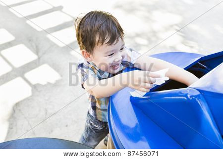 Happy Cute Mixed Race Boy Placing Paper Into The Recycle Bin.