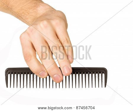 Hairbrush In A Man's Hand On A White