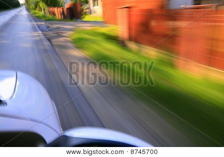 Road And Car With Motion Blur