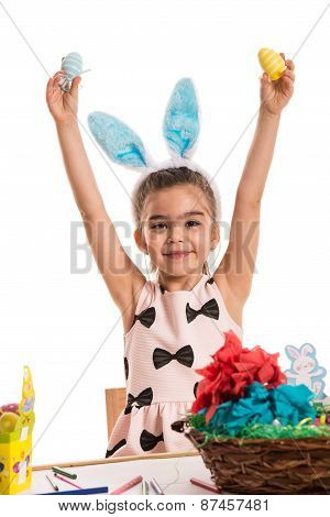 Happy Girl Showing Easter Eggs