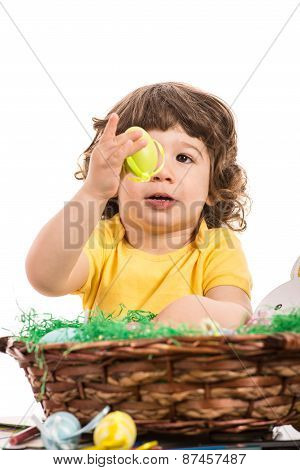 Toddler Boy Looking At Yellow Egg