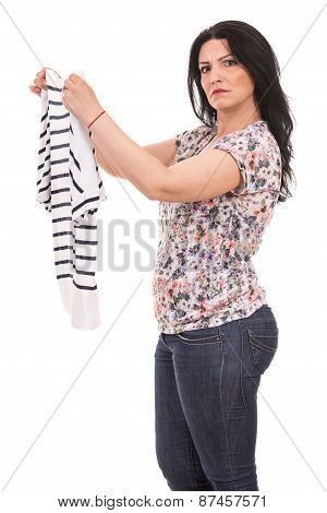 Puzzled Woman Holding New Shirt