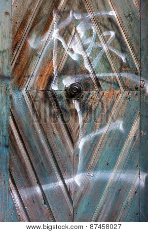 Vandalized wooden door