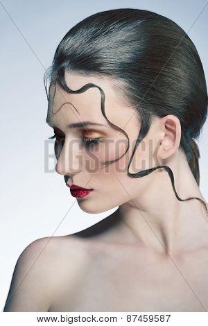 Girl With Make-up And Strange Hairdo