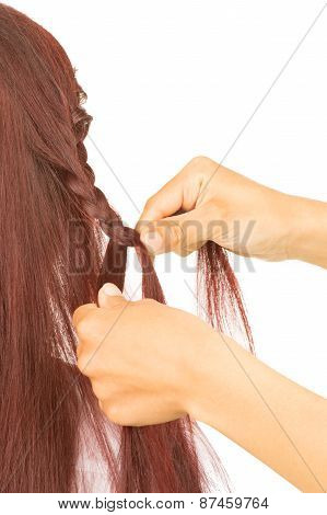 Hands Of Hairdresser Doing A Braid