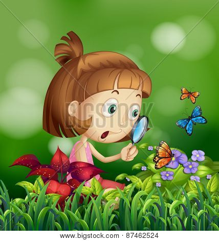Girl looking at the butterflies on the flower