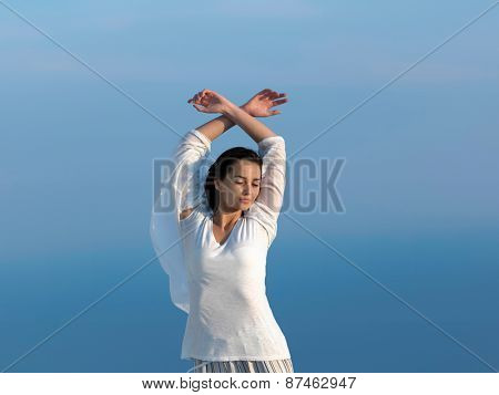 happy young woman enjoy sunset while dancing and enjoy music on headphones