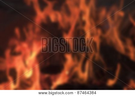 deliberately blurred image of a camp fire flames burning logs as an abstract background